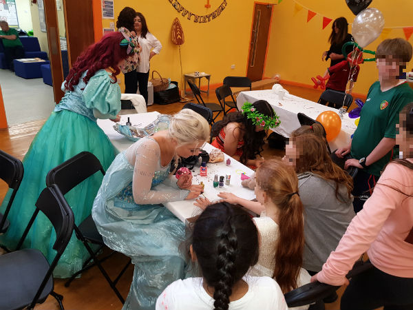 Disney Princesses painting nails at the Swiis North East party